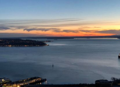 Look at that lonely little sailboat. Imagine being on that lonely little sailboat, watching the sunset in Seattle.